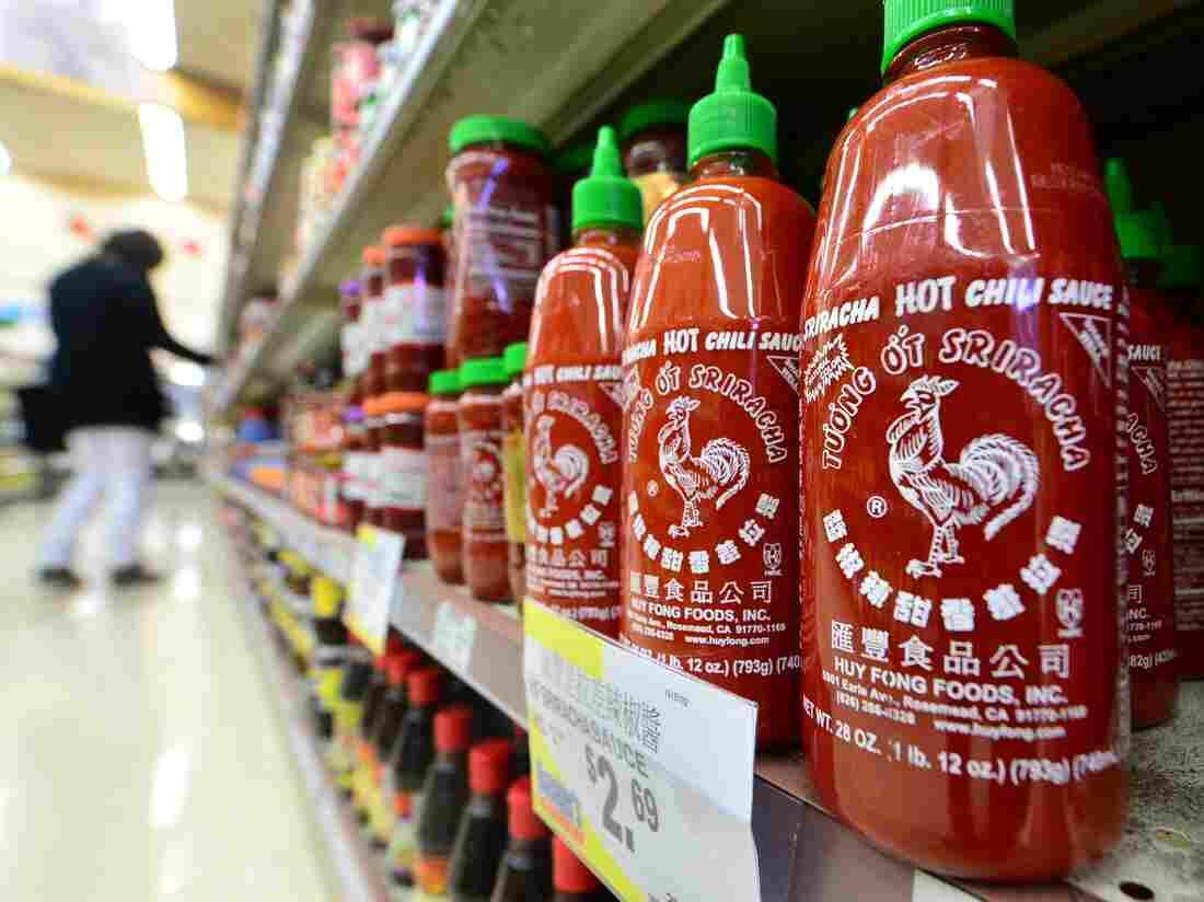 Bottles of Sriracha chili sauce on the shelves of a supermarket in Rosemead, Calif.