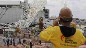 A metal structure atop the Corinthians Arena is seen after a collapse Wednesday in Sao Paulo. The stadium is slated to host the 2014 World Cup opener.