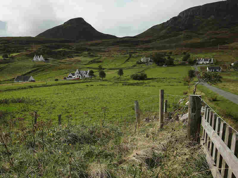 STAFFIN, ISLE OF SKYE, SCOTLAND - OCTOBER 05: Crofter cottages stand on meadows near Quiraing mountain on October 5, 2013 in Staffin, Isle of Skye, Scotland. The Isle of Skye is a popular tourist destination. (Photo by Sean Gallup/Getty Images)