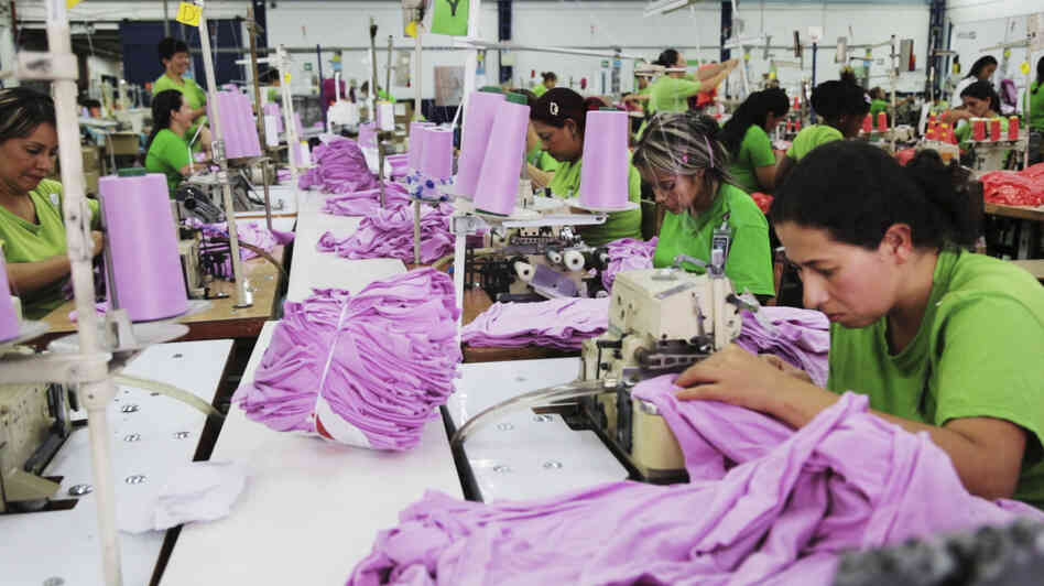 Noreli Morales (right) works on the Planet Money women's T-shirt at a factory in Medellin, Colombia.