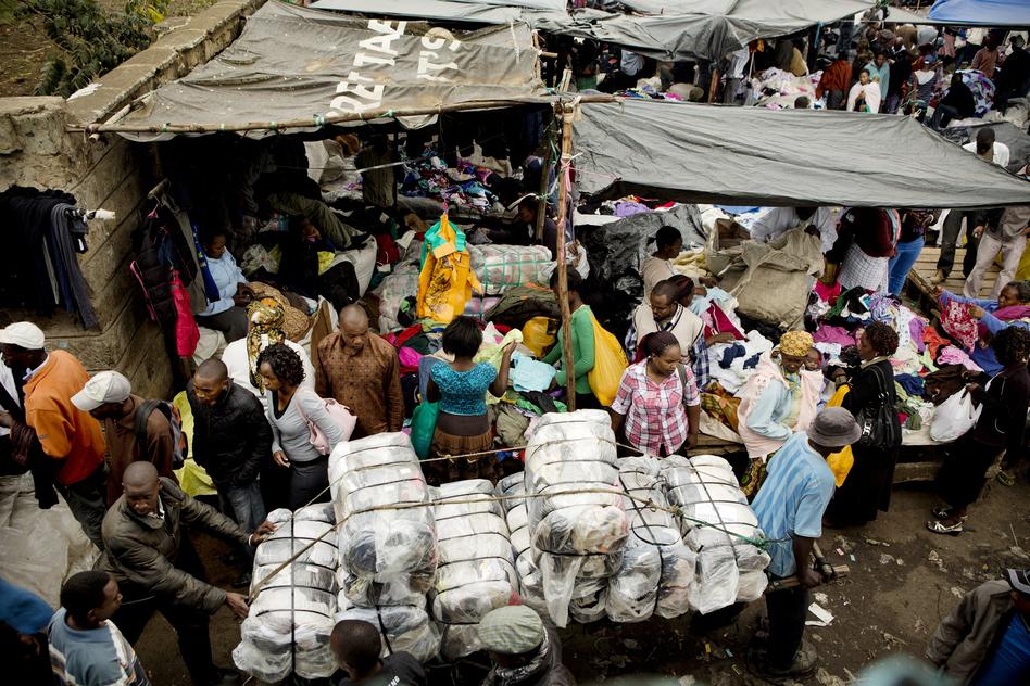 Bales of imported clothing are wheeled into the Gikombo Market in Nairobi, Kenya. (Sarah Elliott for NPR)