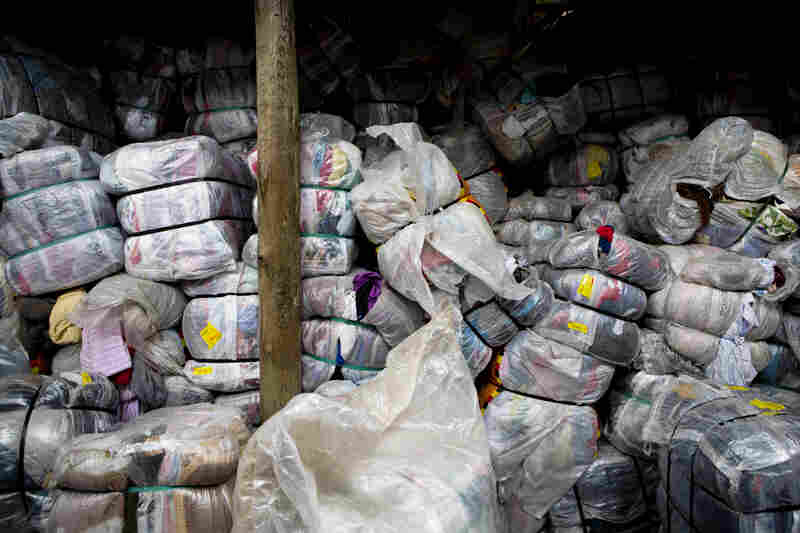 A Kenyan importer of T-shirts waits for vendors to come and buy his bales. Importers will not open the bales for vendors to inspect, passing on the risk of poorly sorted clothes or sizes to the vendors.