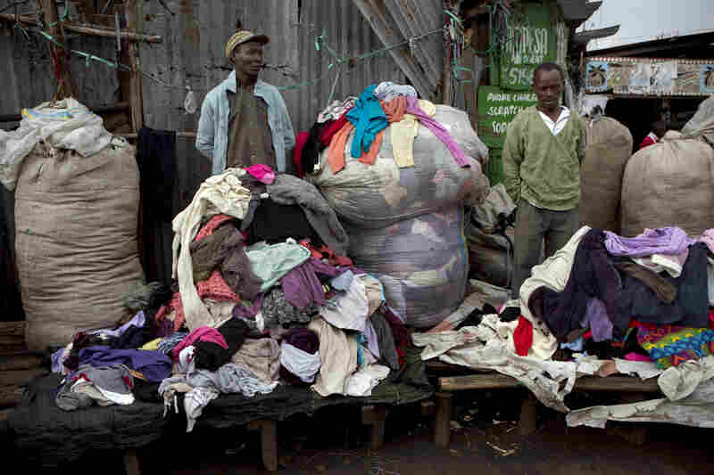 Vendors at Gikombo Market wait for customers to buy their clothes.