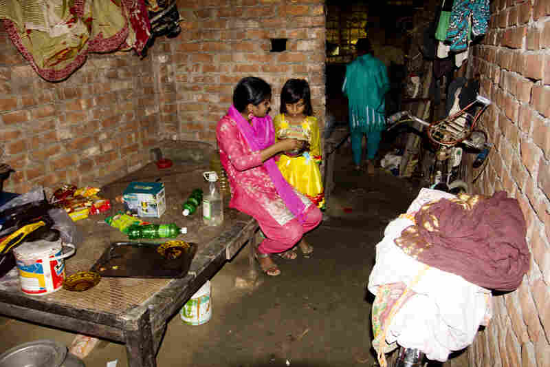 Shumi and Minu say when they grew up in the village there wasn't enough food to eat. They had three younger sisters who all died before they were 7.