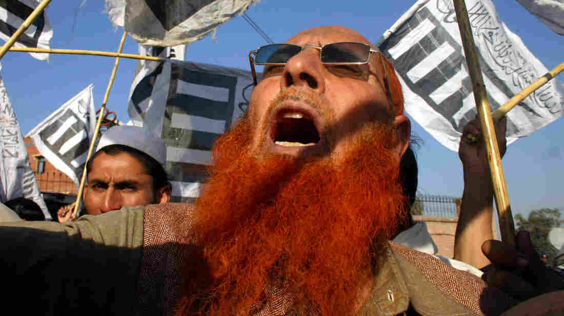 On Friday in Peshawar, Pakistan, supporters of Jamaat-e-Islami party shout slogans during a rally to condemn U.S. drone strikes.