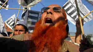 On Friday in Peshawar, Pakistan, supporters of Jamaat-e-Islami party shout slogans during a