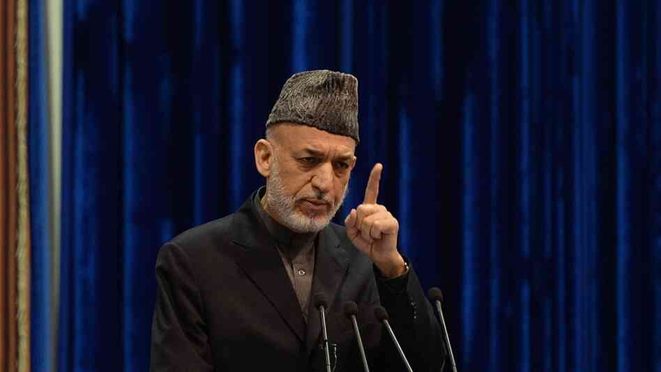 Afghan President Hamid Karzai addresses the Loya Jirga on Sunday. Karzai expressed anger at an airstrike Thursday that killed a child, saying it could imperil a security agreement with the U.S. The U.S.-led international force apologized on