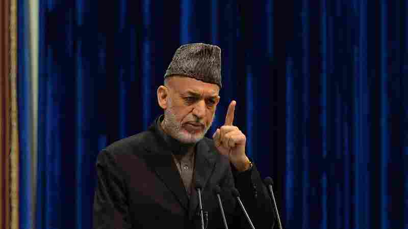 Afghan President Hamid Karzai addresses the Loya Jirga on Sunday. Karzai expressed anger at an airstrike Thursday that killed a child, saying it could imperil a security agreement with the U.S. The U.S.-led international force apologized on Friday for the killing.