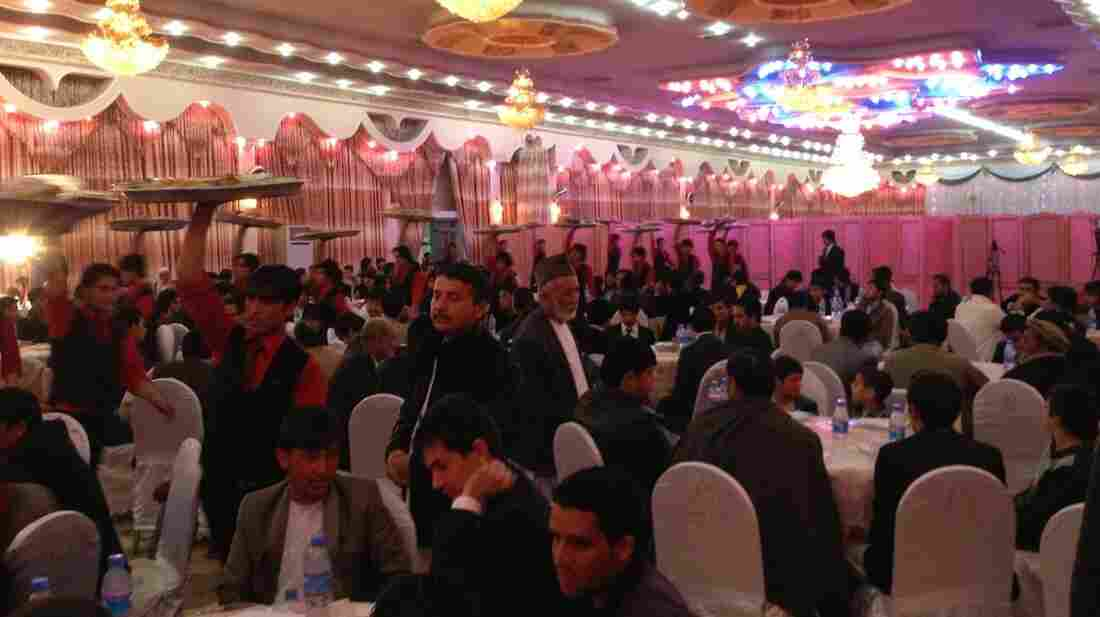 Afghans hold large, expensive weddings, even those involving families of modest means. More than 600 people attended this