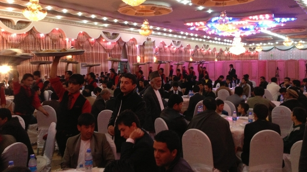 Afghans hold large, expensive weddings, even those involving families of modest means. More than 600 people attended this recent marriage at a large wedding hall in Kabul. (NPR)