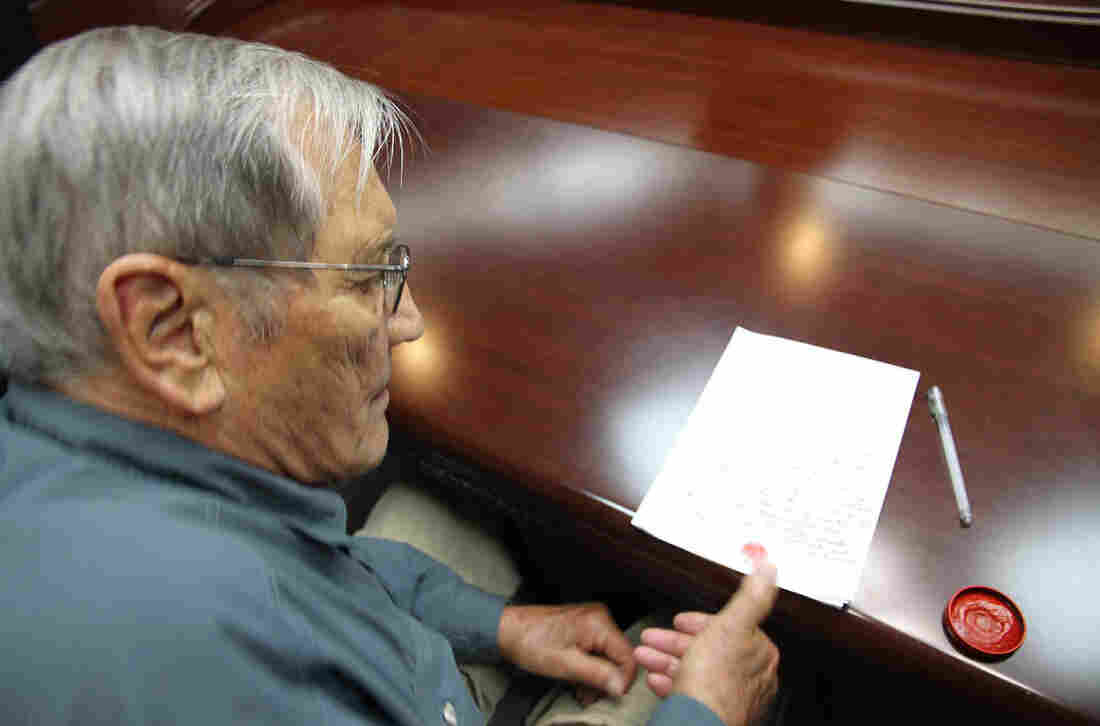 This photo taken on Nov. 9 and released on Nov. 30 by North Korea's official Korean Central News Agency shows American Merrill Newman inking his thumbprint onto a written apology for his alleged crimes both as a tourist and during his participation in the Korean War.