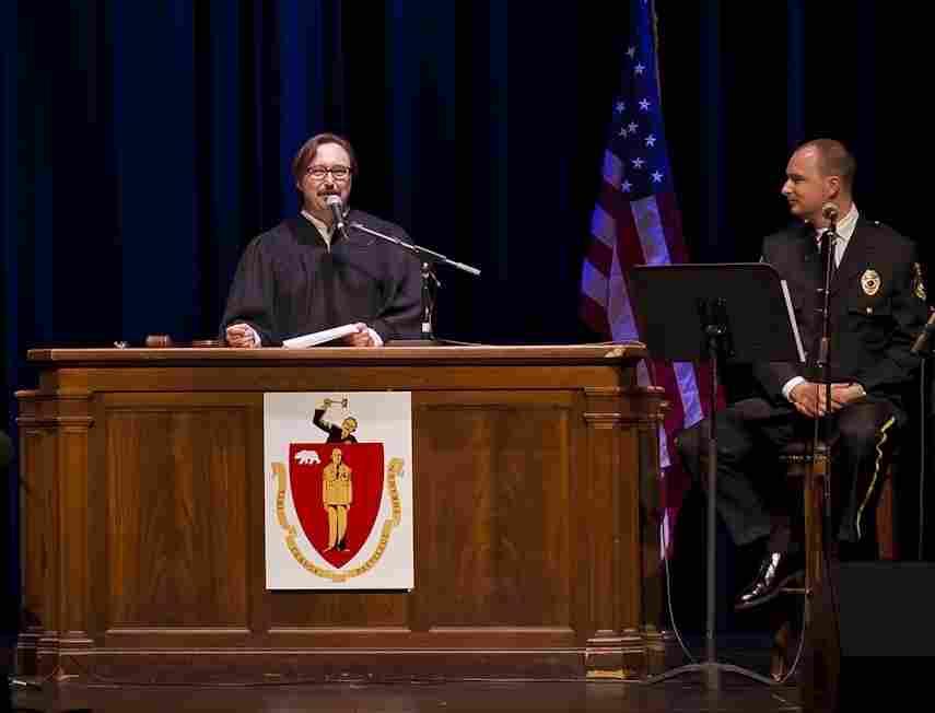 John Hodgman, left, presides over a live taping of the Judge John Hodgman podcast, as Jesse Thorn looks on.