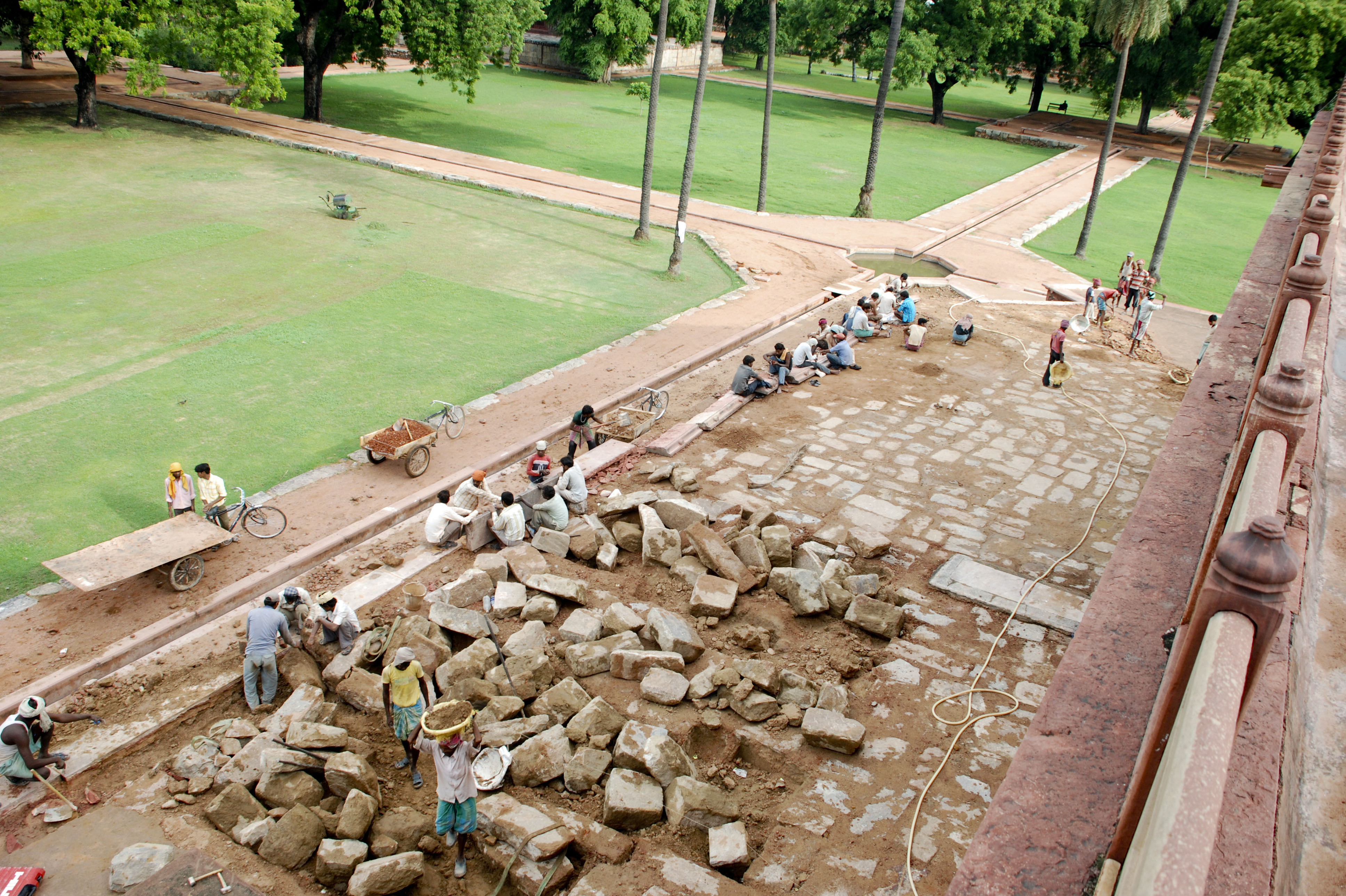 This shows the restoration of the stone paving on the lower plinth. Workmen manually lifted some 12,000 square meters of stone blocks, most weighing more than a ton, to put in replacements.