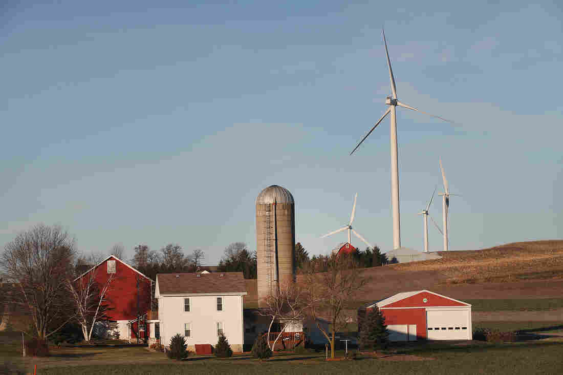 Wind turbines twirl above farmland on the outskirts of Madison,