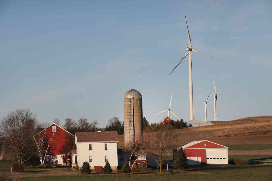 Wind turbines twirl above farmland on the outskirts of Madison, Wis. Not all locals are pleased.