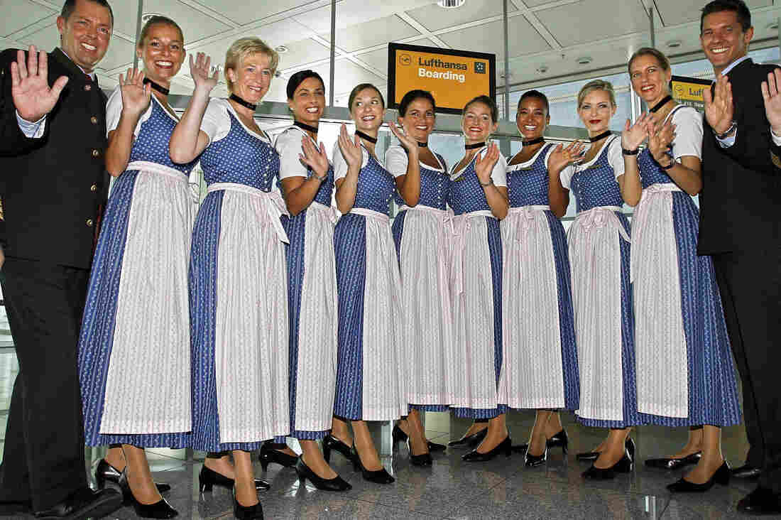 Crew members of German airline Lufthansa pose in traditional Bavarian dresses at the Munich airport in southern Germany.