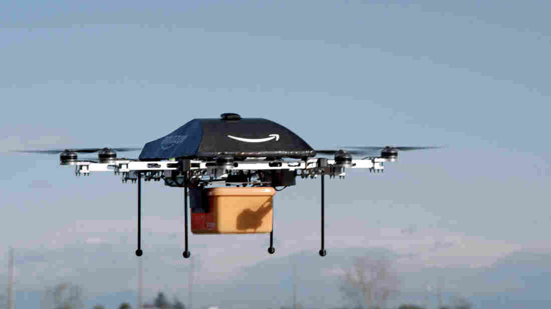 In an image taken of a test flight, an Amazon Prime Air drone carries a package. The online retailer could begin 30-minute deliveries within four to five years, CEO Jeff Bezos told 60 Minutes Sunday.