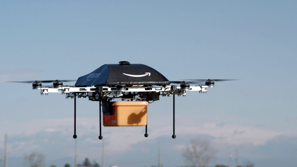 In an image taken of a test flight, an Amazon Prime Air drone carries a package. The online retailer could begin 30-minute deliveries within four to five years, CEO Jeff Bezos told <em><em>60 Minutes</em></em> Sunday. (Amazon)