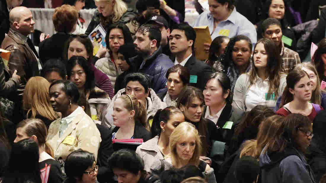 Job seekers attend a March health care job fair in New York.