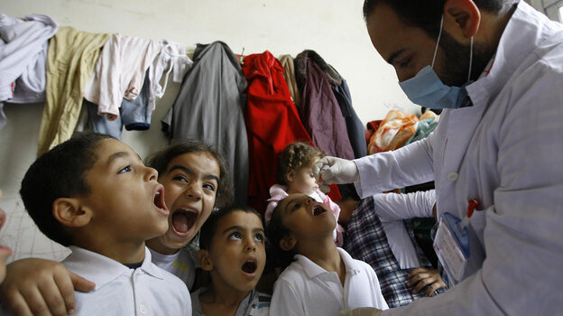 Syrian boys line up to get the polio vaccine at a refugee camp in Sidon, Lebanon, on Nov. 7. The Lebanese government plans to vaccinate all kids under age 5 for the virus, including Syrian refugees.