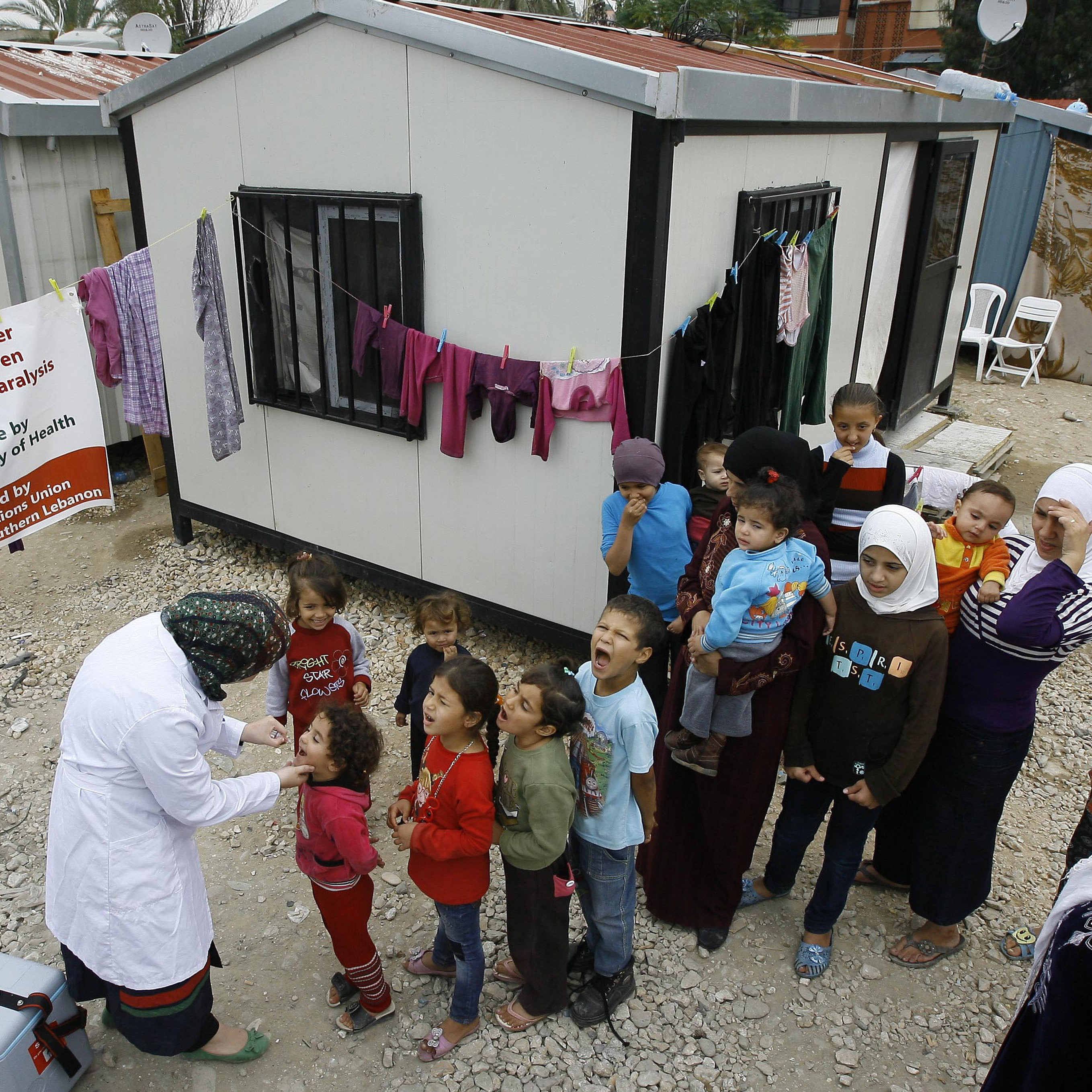 Syrian children at a refugee camp in Sidon, Lebanon, wait for the polio vaccine on Nov. 7.