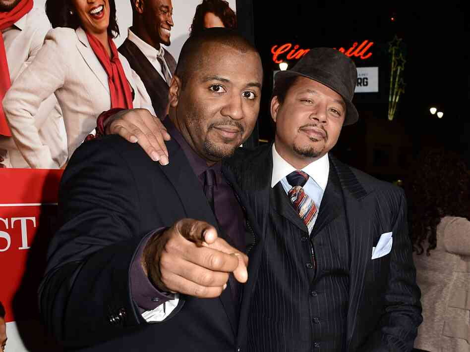 Director Malcolm Lee (left) and actor Terrence Howard on the red carpet for the world premiere of their movie, The Best Man Holiday.