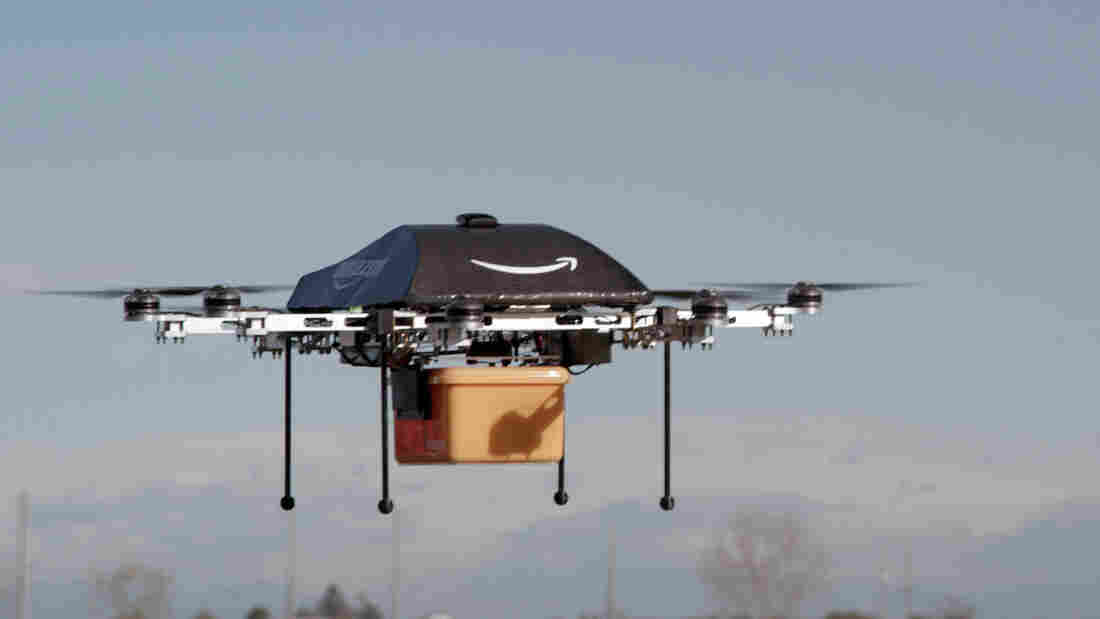 Buzzing to a neighborhood near you? Amazon.com's Prime Air prototype may someday fly small packages right to customers' homes.