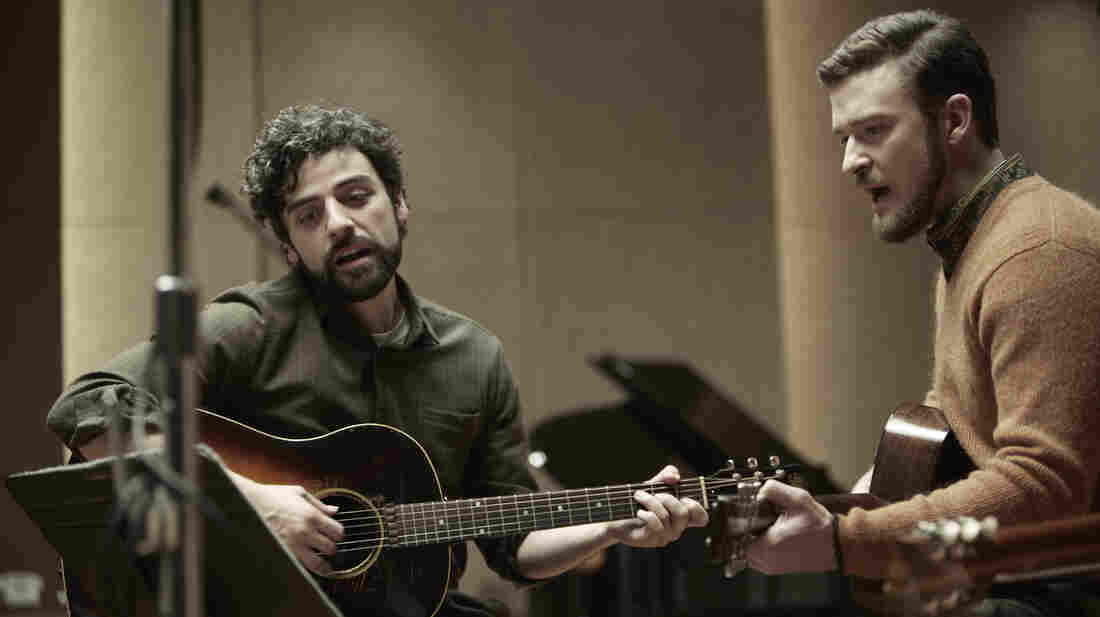 Folk singer Llewyn Davis (Oscar Isaac, left) is barely surviving the 1961 winter in New York, living off the proceeds of his occasional gigs — and the kindness of friends like Jim (Jus