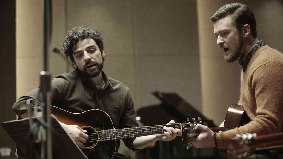 Folk singer Llewyn Davis (Oscar Isaac, left) is barely surviving the 1961 winter in New York, living off the proceeds of his occasional gigs — and the kindness of friends like Jim (Justin Timberlake).