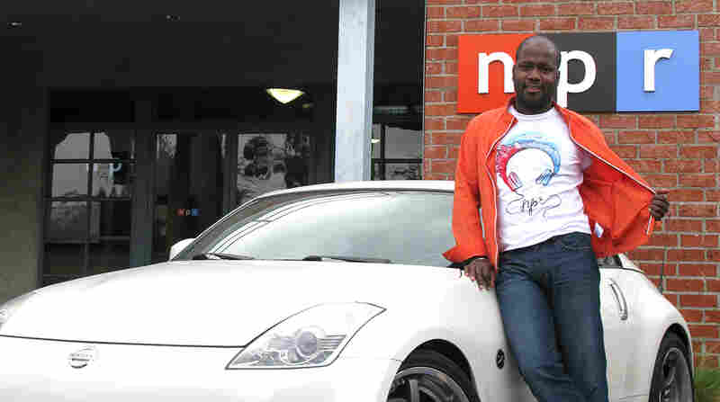 Representing NPR West, we have the Business Desk's Auto Reporter Sonari Glinton. He has paired his NPR shirt with jeans, an orange jacket and a sports car.