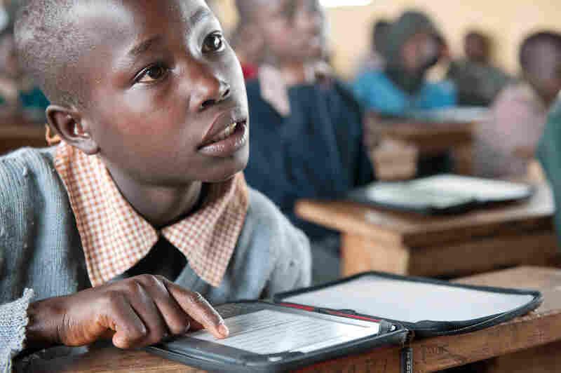 A student at Ntimigom School in Kilgoris, Kenya, uses his e-reader.