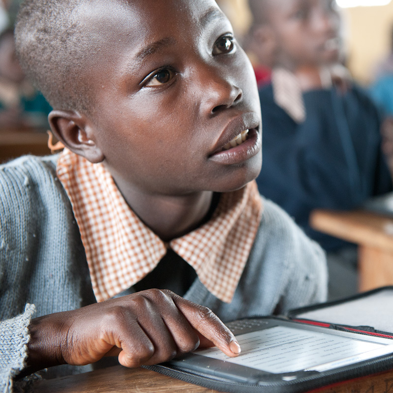 A student at Ntimigom School in Kilgoris, Kenya, uses his e-reader.