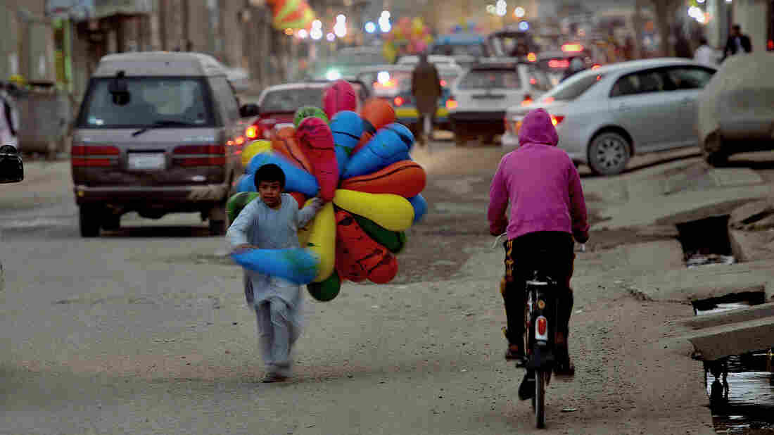 A young Afghan balloon seller runs toward a customer in Kabul on April 2. Afghanistan, North Korea and Somalia are the most-corrupt countries, according to the annual Corruption Perception Index released Tuesday.