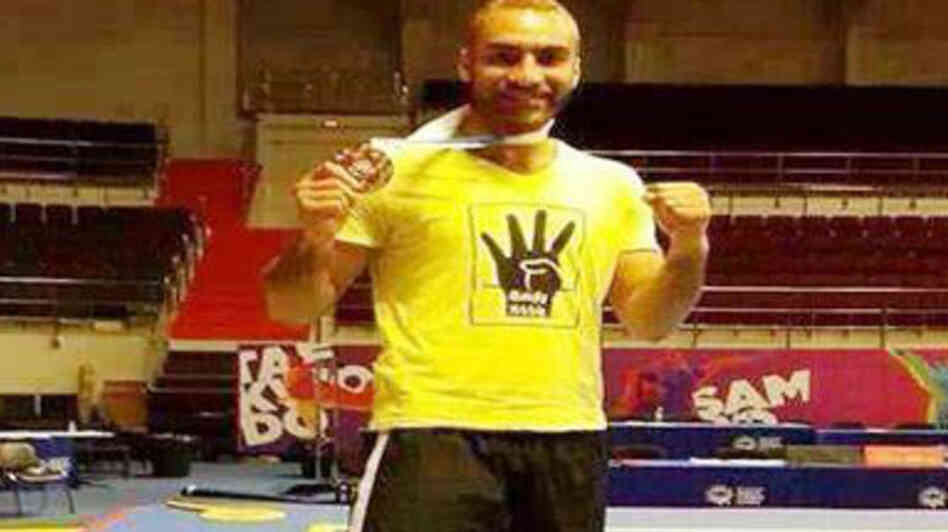 Egypt's Mohamed Yousef won a gold medal at the kung fu championships in Russia in October. He then put on a yellow T-shirt with a four-finger salute to express solidarity with protesters opposing Egypt's military-backed government. Egyptian sports officials have suspended him and barred him from tournaments for a year.