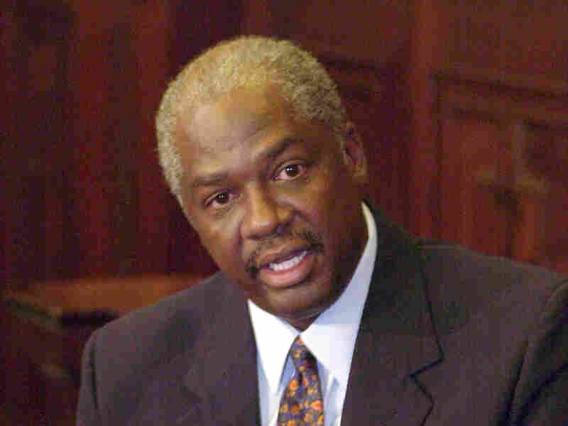 Ronnie White, then-chief justice-elect of the Missouri Supreme Court, talks with reporters in June 2003.