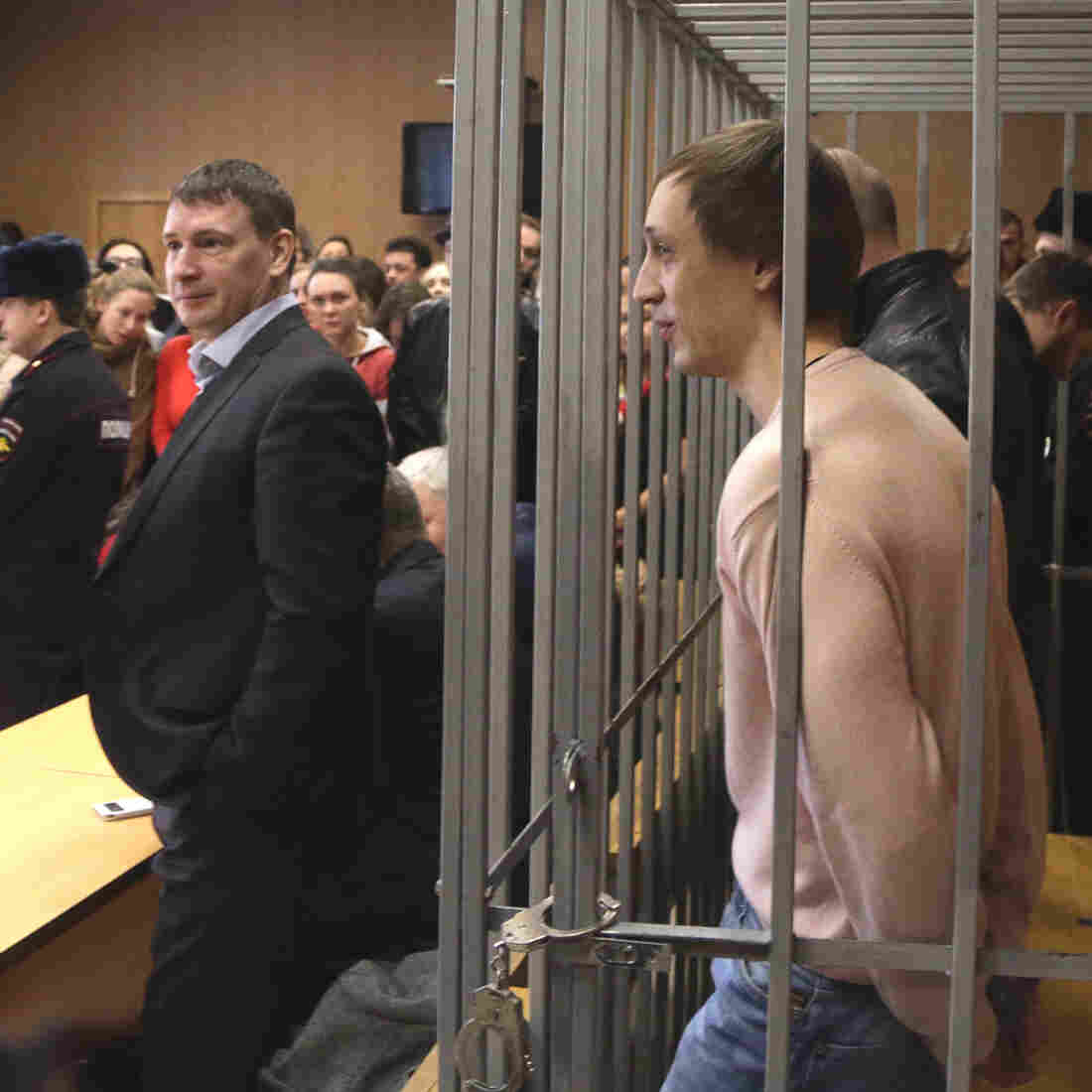 Pavel Dmitrichenko, a former leading dancer in Russia's Bolshoi ballet, stands inside the defendant's cage in a Moscow court Tuesday. He was sentenced to six years in prison for ordering an acid attack on the Bolshoi's artistic director, Sergei Filin.