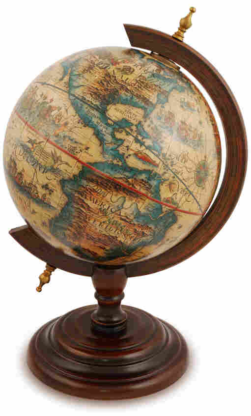 Antique globe from a red wood.