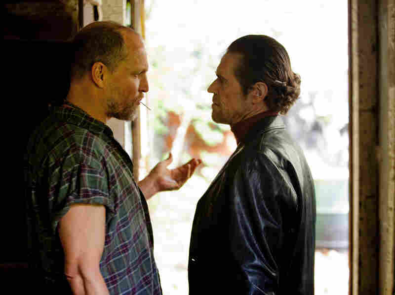 Rodney gets mixed up with the wrong kind of people while Russell is in prison, including a loan shark (Willem Dafoe, right), and a psychotic bookie (Woody Harrelson, left).