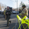 Connecticut State Police walk near the scene of the Sandy Hook Elementary School shooting on Dec. 14, 2012, in Newtown.
