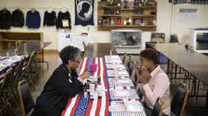 Air Force Staff Sgt. Bri Smith (right) of Atlanta talks with a Mary Kay consultant during a November job fair