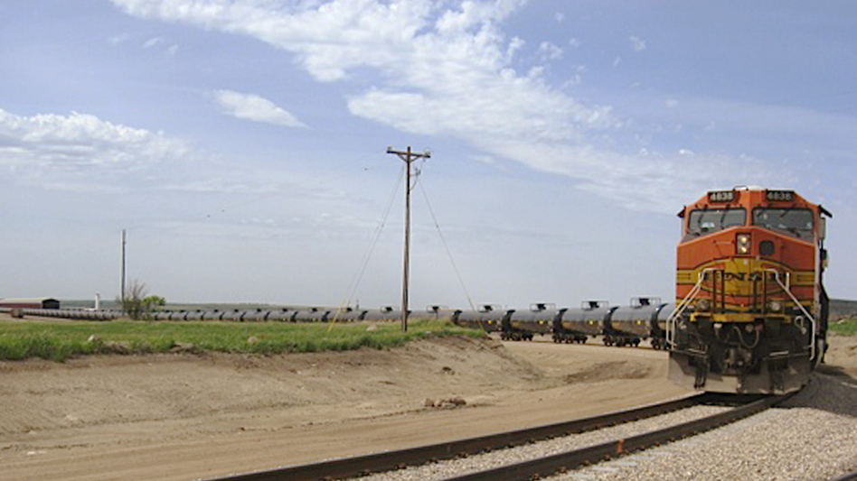 A train leaves the Rangeland Energy company's crude oil loading terminal near Epping, N.D. So far this year, 60 percent of all oil produced in North Dakota left the state by rail. One economist says there aren't enough oil tankers to fill the demand. (AP)