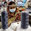 Workers sew together the Planet Money t-shirt in Chittagong, Bangladesh.