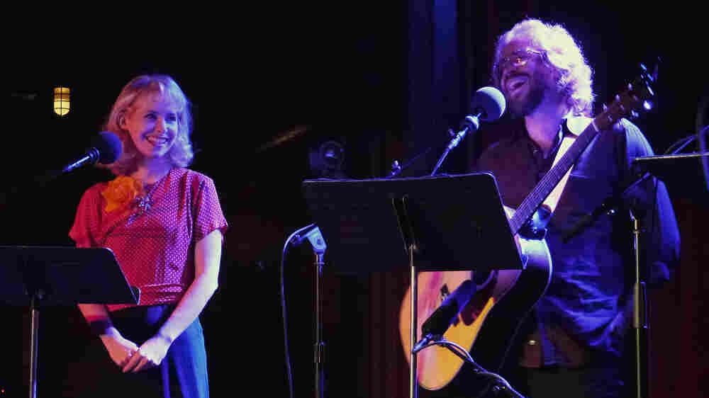 "Singer-songwriter Nellie McKay (left) and house musician Jonathan Coulton ham it up at The Bell House in Brooklyn, NY, with a rendition of the tune ""Get Along Little Doggies."""
