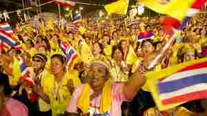 Anti-Government protesters shout during a celebration in Bangkok for the Thai King Bhumibol Adulyadej on his 86th birthday, on Thursday.