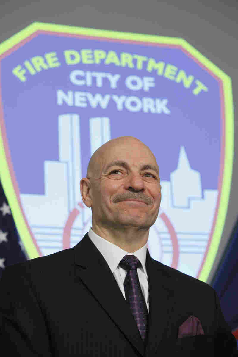 Salvatore Cassano smiles during a news conference following his swearing-in as New York City's fire commissioner.