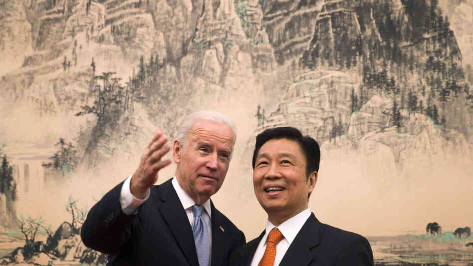 Vice President Biden chats with his Chinese counterpart Li Yuanchao before heading to their luncheon at the Diaoyutai State Guesthouse in Beijing on Thursday.
