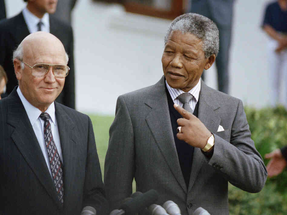 Nelson Mandela with South African President F.W. de Klerk in May 1990. Mandela died Thursday at 95.