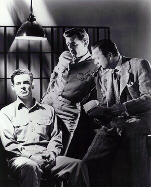 A lot of what we think we know about interrogation tactics comes from television and movies. Above (from left), Robert Ryan, Robert Mitchum and Robert Young appear in a scene from the 1947 film Crossfire.