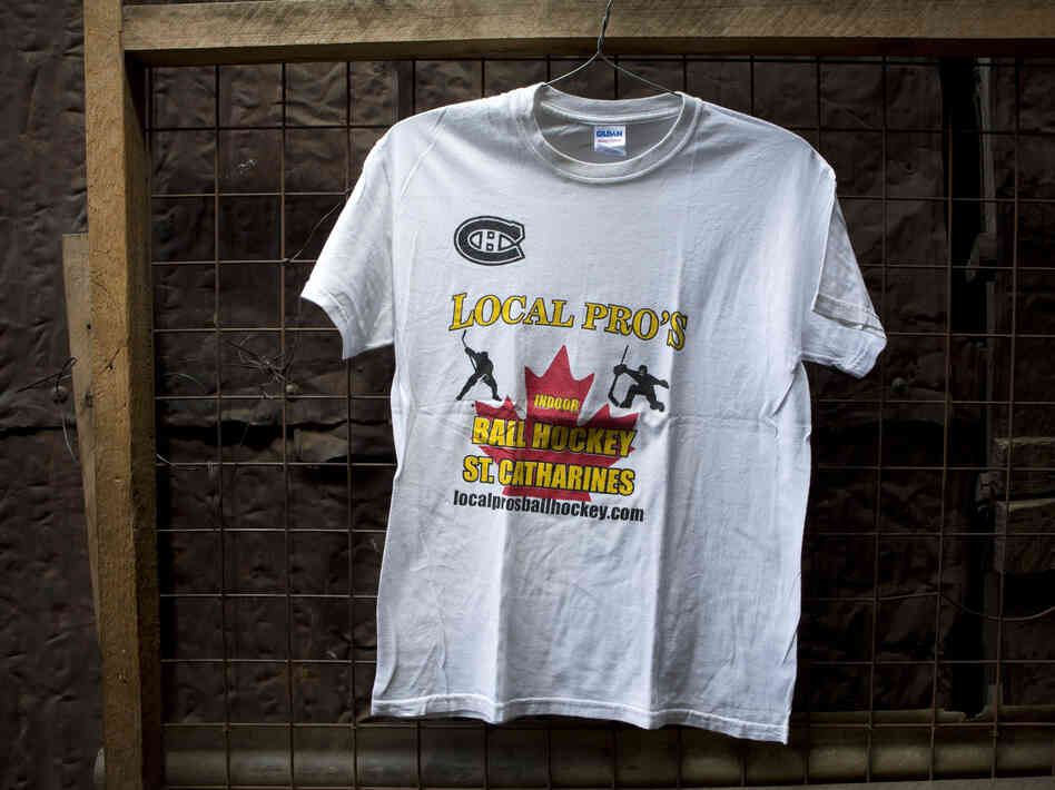 "A T-shirt for sale at Gikombo Market in Nairobi, Kenya. The shirt reads ""Local Pro's Indoor Ball Hockey St. Catharines."""