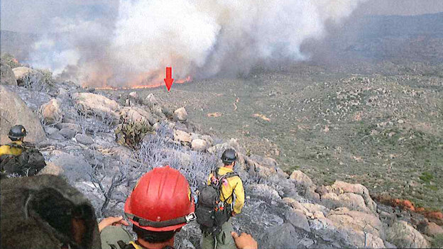 A photo taken by the Granite Mountain Hotshots on June 30 shows their position on a ridge, with a red arrow indicating the original location of their lookout. Th
